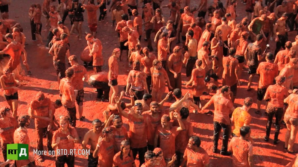 Aerial photograph of a crowd soaked in tomato juice during a tomato fight in the Netherlands. Still taken from RTD documentary Apples of Discord.