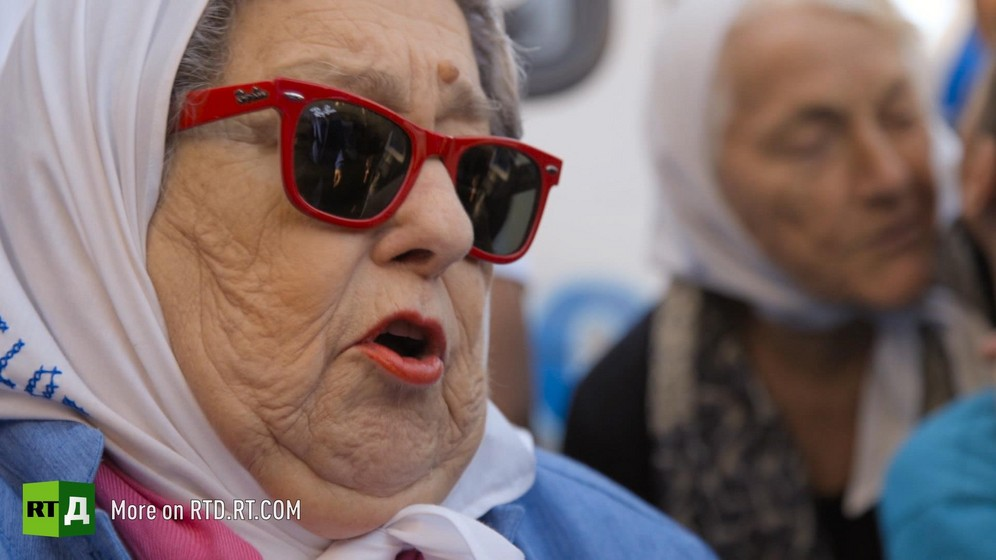 Head of a grandmother wearing a headscarf and sunglasses during a grandmothers' demonstration at the Plaza di Mayo in Buenos Aires, Argentina. Still taken from RTD documentary Argentinian DNA: The Fracture.