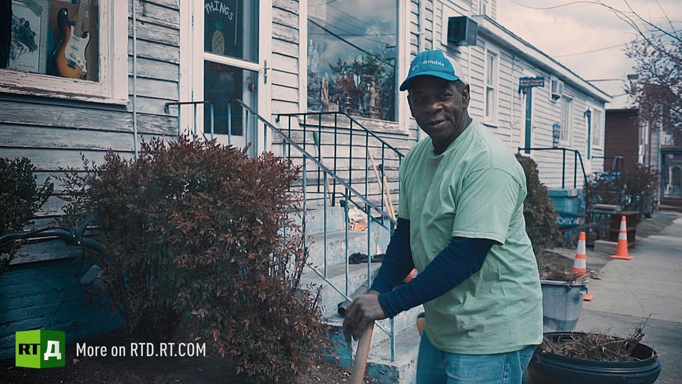 Bruce Stewart, an African American father, in front of a clapboard house. Still taken from RTD documentary, Black Lives 10: Trap.