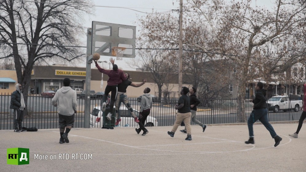 Teenagers play basketball
