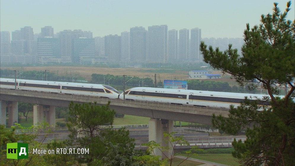 A Chinese high speed train going over a bridge. Still taken from RTD documentary Chinese Speed  in the This  is China series.