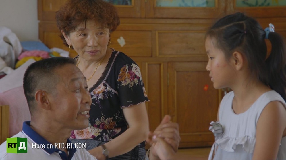 Before taking his first journey on one of China's high speed trains, a Chinese grandfather says goodbye to his granddaughter and daughter.Still taken from RTD documentary Chinese Speed  in the This is China series.