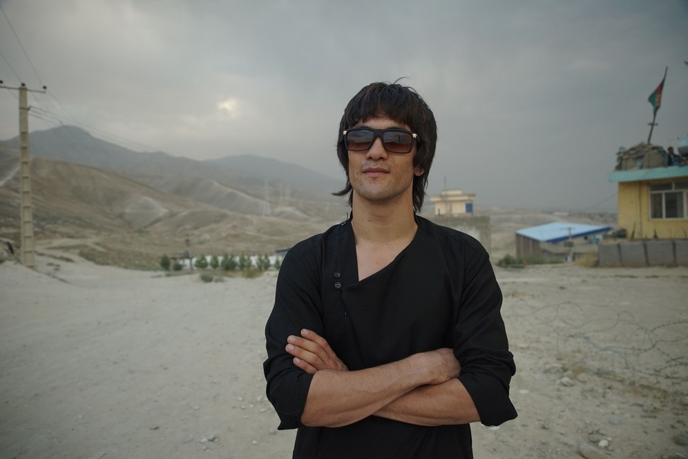Abass Alizada , the Afghan Bruce Lee lookalike, is standing outdoors. Shot taken while fiming RTD documentary Dragon of Afghanistan.