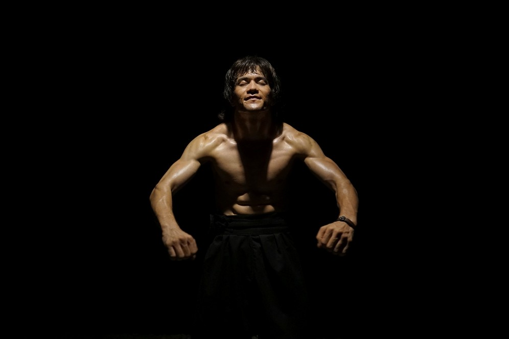 Abbas Alizada, the bruce Lee lookalike, displays his muscular torso. Shot taken while fiming RTD documentary Dragon of Afghanistan.