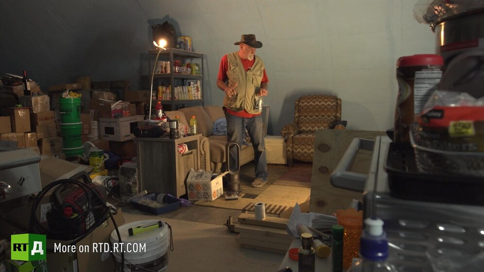 Survivalist in his bunker with stocks of food. Still taken from RTD documentary Armageddon Ready