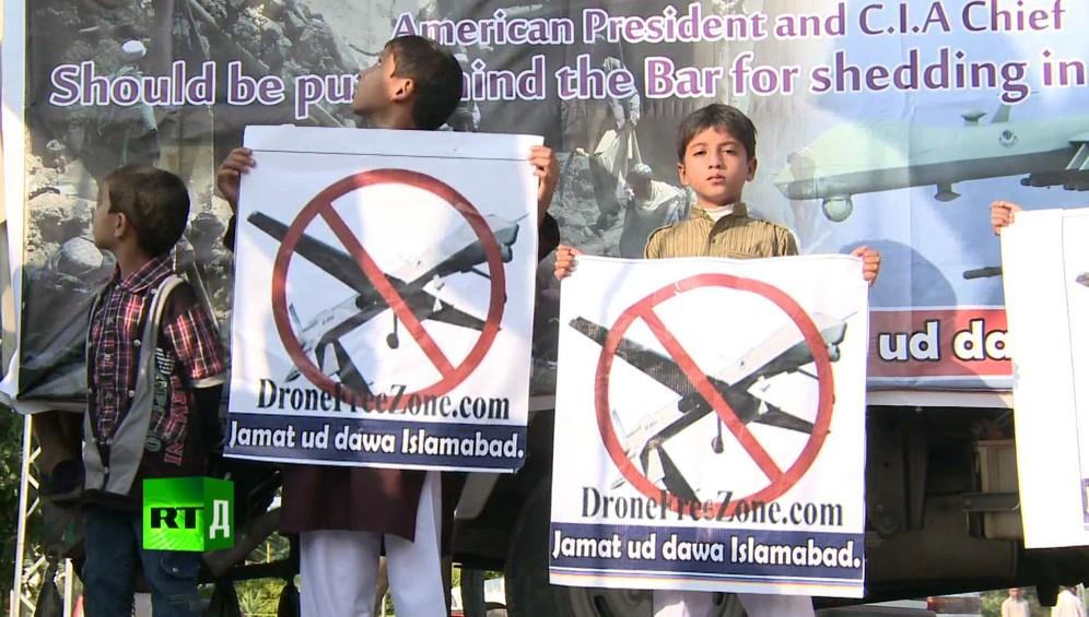 Three young boys holding anti-drone posters during a demontration against the United States' use of drones in Pakistan. Taken while shooting RTD documentary on the impact of drones, Game of Drones.