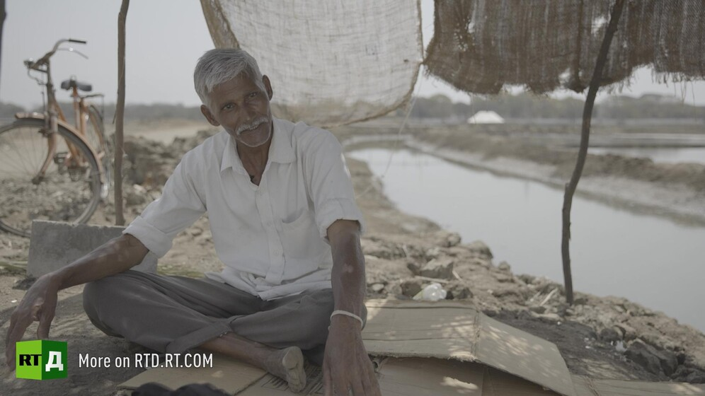 Indian salt farmer. Still taken from RTD documentary Gandhi's Footsteps.