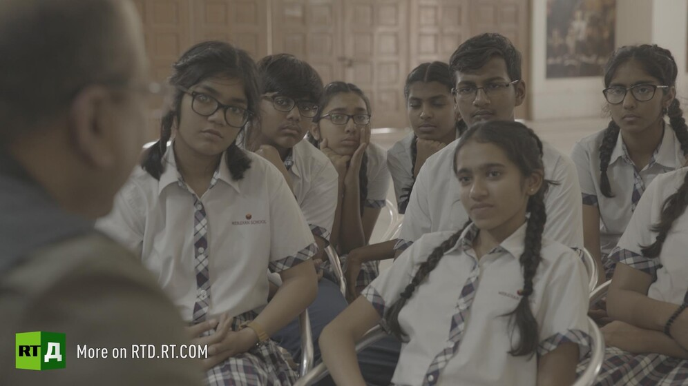 Indian children in school uniform. Still taken from RTD documentary Gandhi's Footsteps.