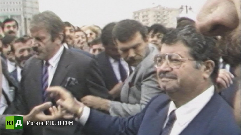 1980s Prime Minister of Turkey Turgut Ozal outside, surrounded by security. Still taken from RTD's documentary series on Fethullah Gulen, The Gulen Mystery, Episode 3: Gulen's Businessmen.