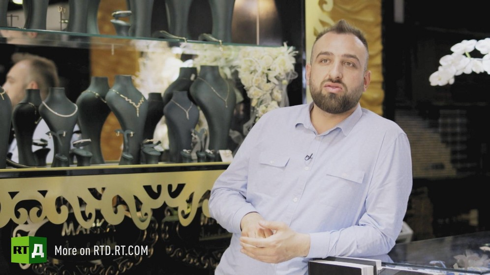 Man in his thirties wearing a beard in his jewelry shop in Germany. Still taken from RTD's documentary series on Fethullah Gulen, The Gulen Mystery, Episode 3: Gulen's Businessmen.