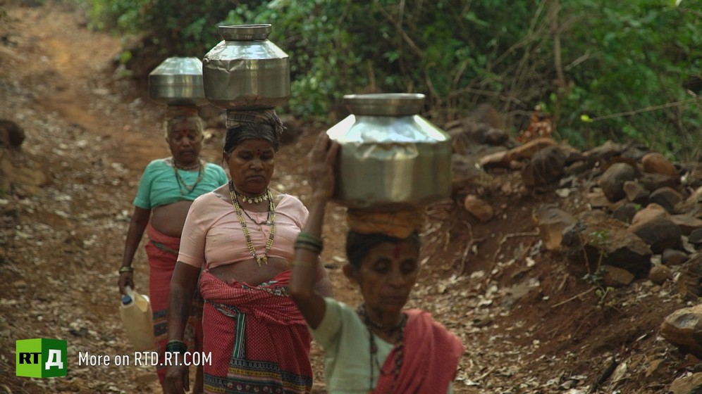 Indian women carry water