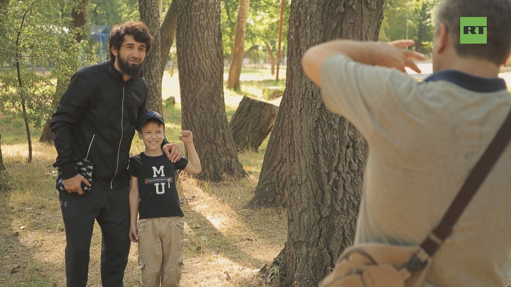 Zabit Magomedsharipov with a young fan in Dagestan. Still taken from RT Sport documentary Dagestan:Land of Warriors.