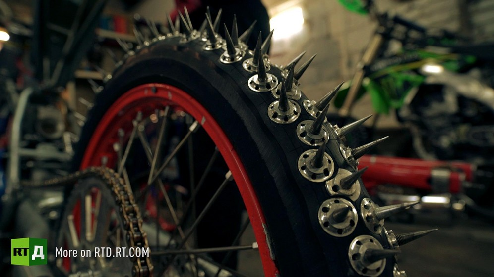 Motorcycle wheel with spikes for ice speedway racing.