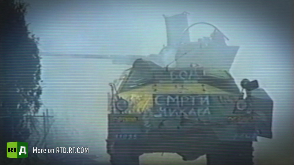 Tank with slogan painted in cyrillic surrounded by smoke / Archive footage from Republika Srpska Radio and Television.