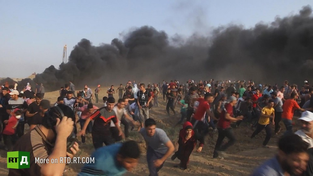During Gaza's Matrch of Return, Palestinians run away from black smoke. Still taken from RTD documentary Palestine in Seeking Recognition series.