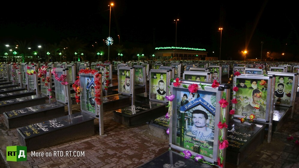 Wadi Al-Salam cemetery in Najaf, Iraq, lit up headstones of militia at nighttime. Still taken while filming the RTD documentary Sons of the Graveyard.