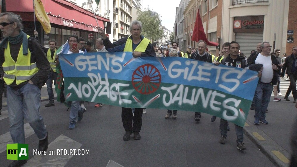 "Yellow Vest protestors hold a French Gypsy banner saying ""Gens du voyage Gilets Jaunes"" in France. Still taken from RTD documentary Tolerance du Voyage."