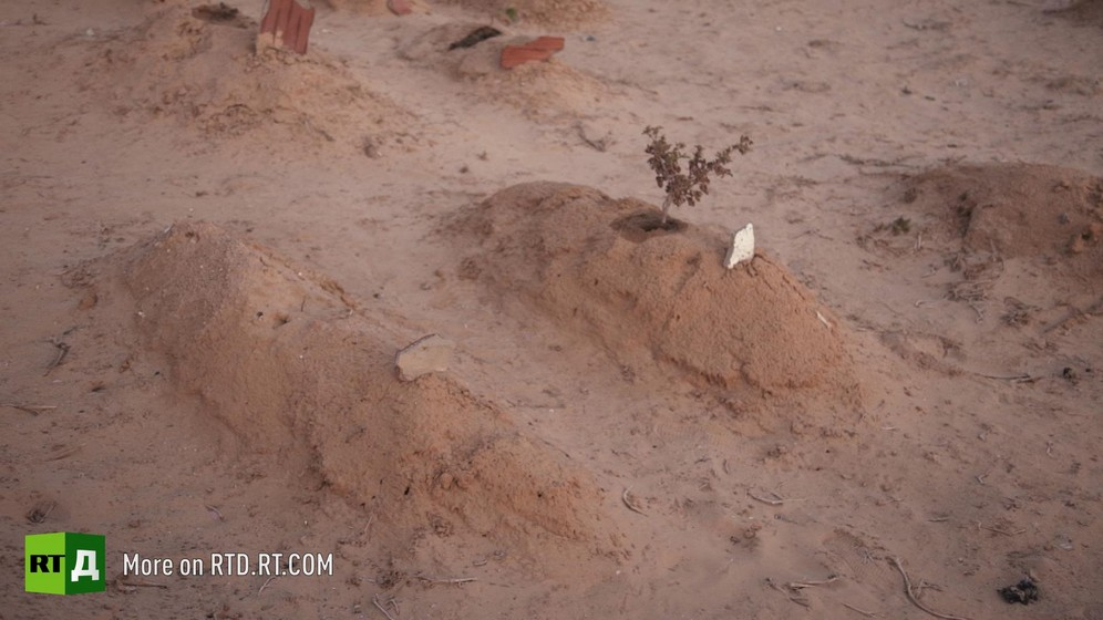 Two graves in Chamseddine Marzoug's cemetery of the unknown, Tunisia. Still taken from RTD documentary Fisher of Men.