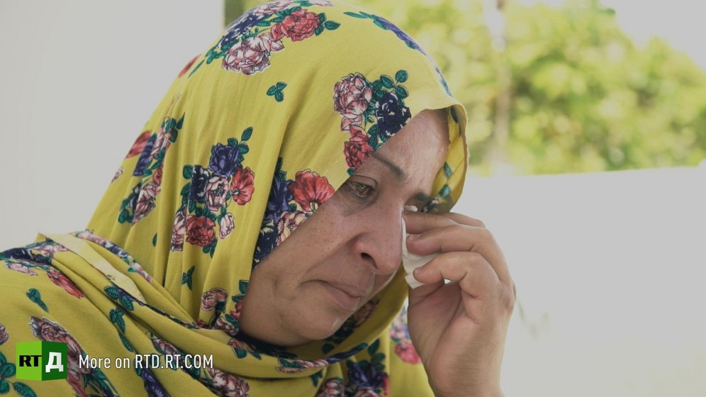 Chamseddine Marzoug's wife wiping a tear. Still taken from RTD documentary Fisher of Men.