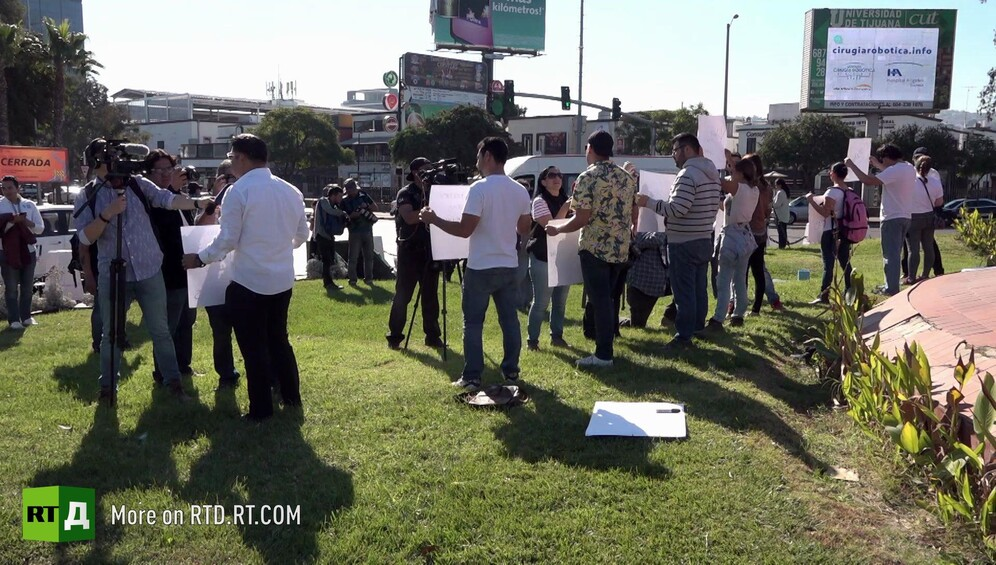 Protesters supporting the migrant caravan being filmed by journalists in Tijuana, Mexico. till taken from RTD documentary