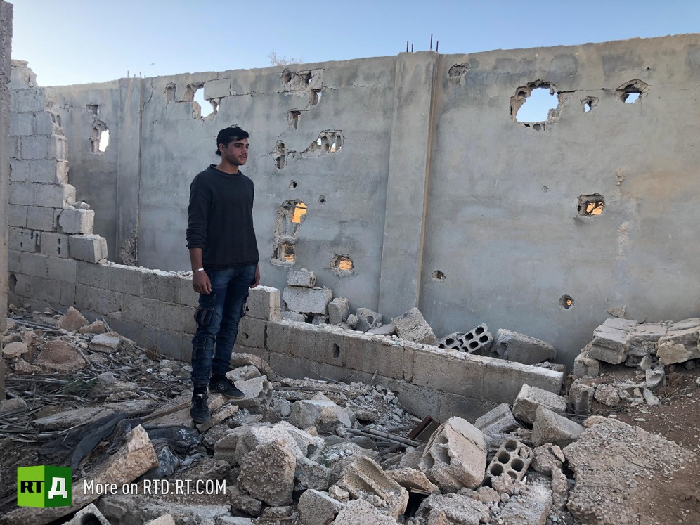 'We watched them from here. If they advanced, we fired back'. Imad, a former child soldier, shows an RTD film crew the hideout where he was taken to monitor the Syrian Army for terrorist militants.