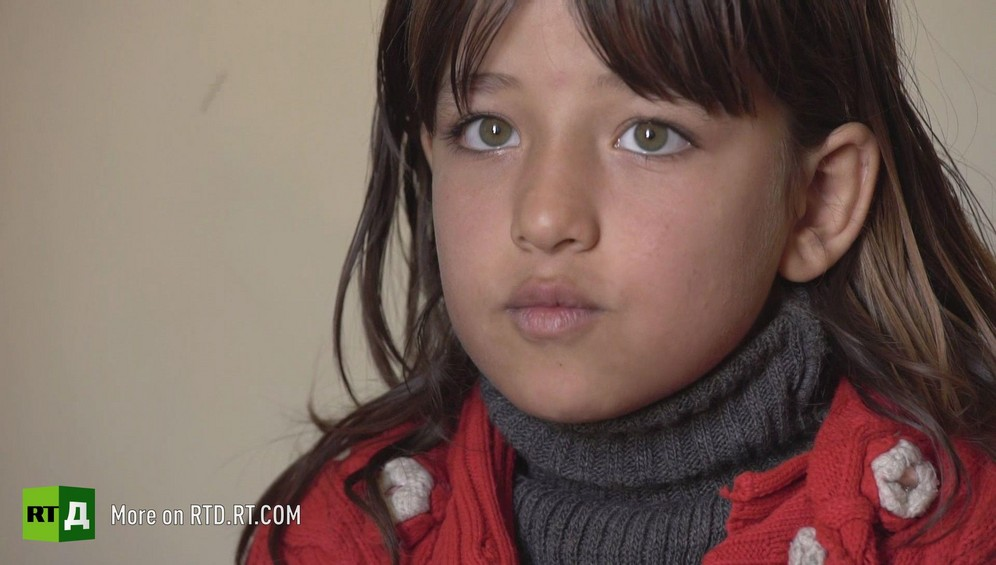 Face of frightened little girl from Aleppo Province, Syria. She had to serve as an auxiliary for rebel soldiers while Al Qaed then ISIS occupied her town. Still taken from RTD documentary about child fighters Where Childhood Died.
