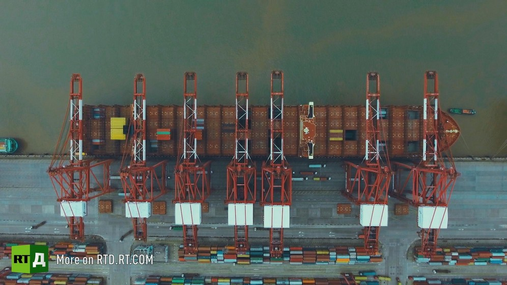 Container ship in Yangshan city port, China, seen from crane. Still taken from RTD documentary Yangshan City Port in the Still taken from RTD documentary Yangshan City Port in the 'This is China' series.
