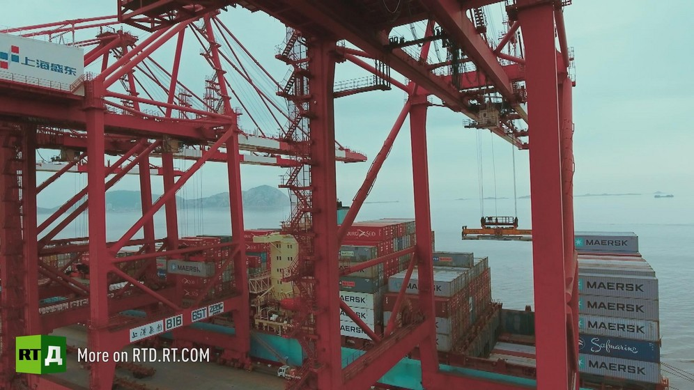 Cranes and container ships at Yangshan container port in China. Still taken from RTD documentary Yangshan City Port in the 'This is China' series.