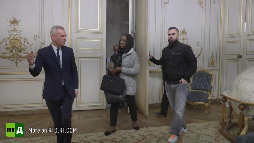 French Environment minister Francois de Rugy shows Yellow Vest spokespeople Priscillia Ludosky and Eric drouet into a ministry room. Still taken from RTD documentary Yellow Vest Fever.