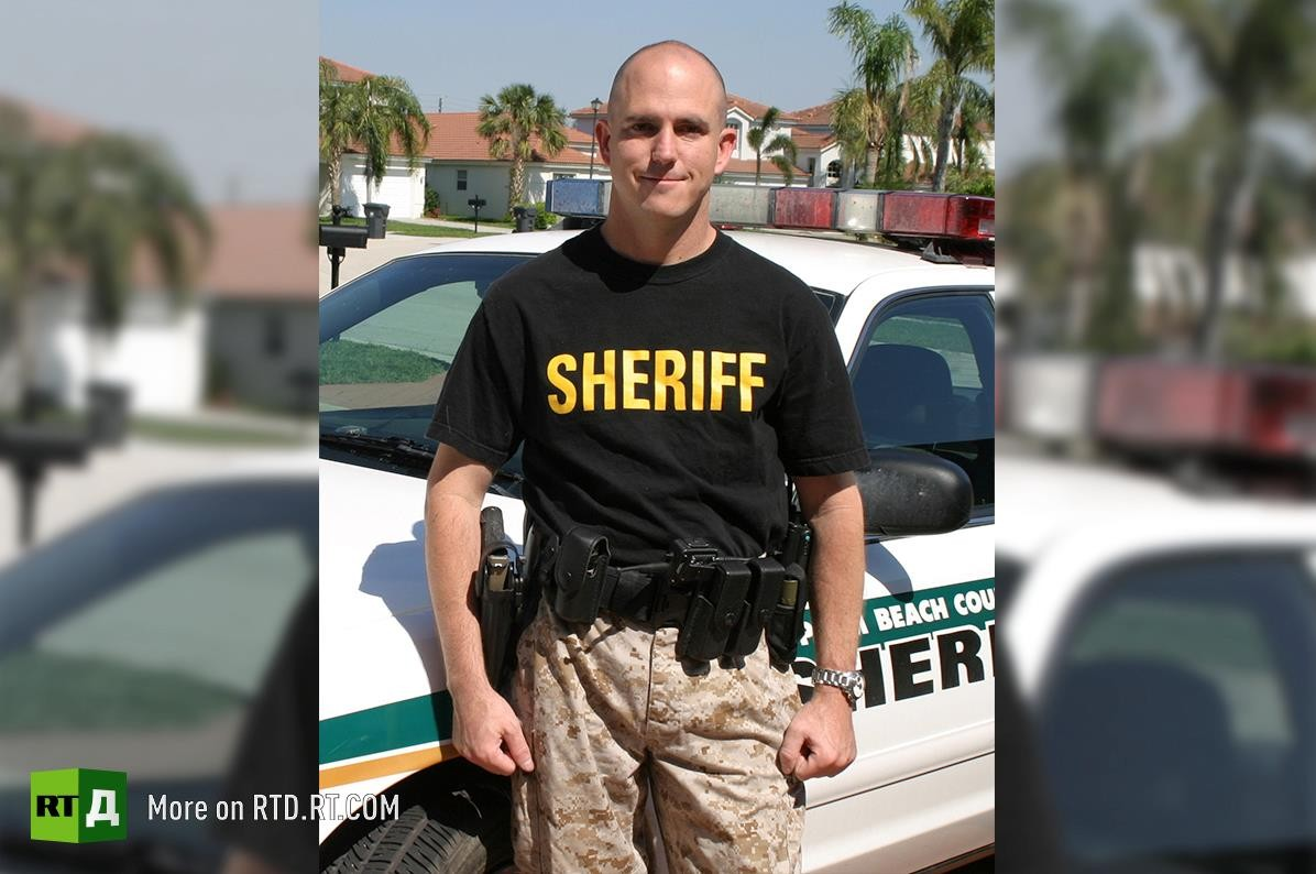"John Mark Dougan worked as a police officer for the Palm Beach County Sherriff's Office in Florida from 2002 to 2008. He resigned because of the ""blatant criminal activity"" he witnessed in law enforcement."