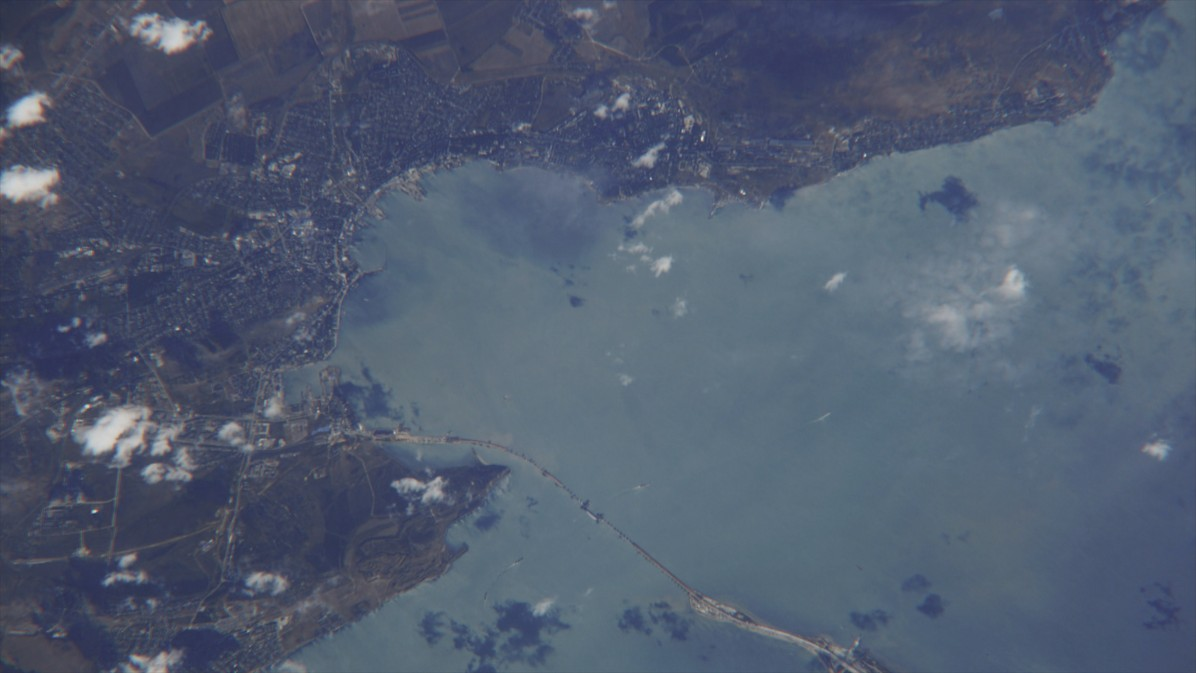 A photo of the Crimean Bridge and the Kerch Strait taken by Russian cosmonaut Sergey Ryazansky from the International Space Station. © A still from the documentary film The Bridge.