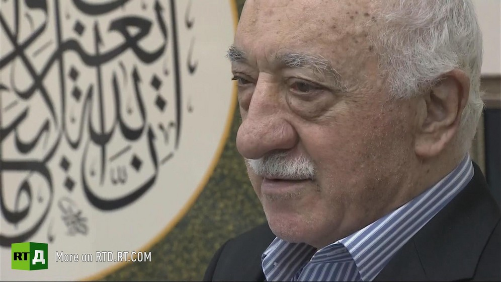 Headshot of Fethullah Gulen next to an inscription in arabic, at his home in Pennsylvania, USA. Still taken from RTD's documentary series The Gulen Mystery.