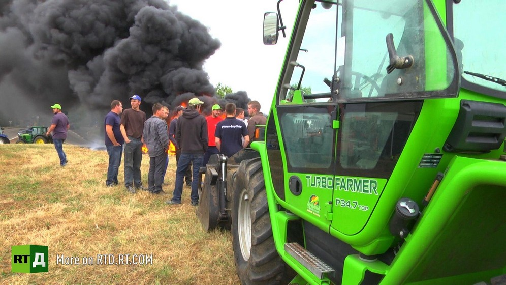 French farmers protesting, tractor and black smoke in background. A still taken from RTD documentary on russian sanctons on EU farm produce, Apples of Discord.