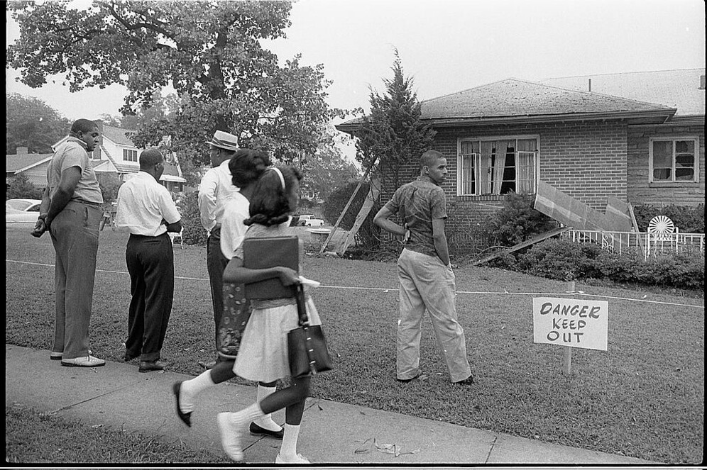 people viewing the bomb-damaged home of a black attourney in alabama