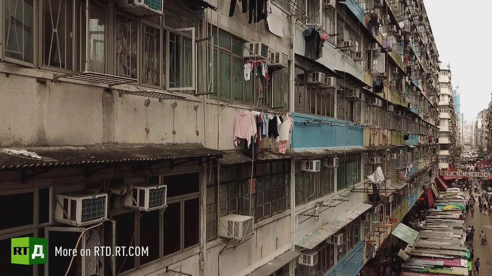 Hong Kong cage houses temporary housing for immigrants