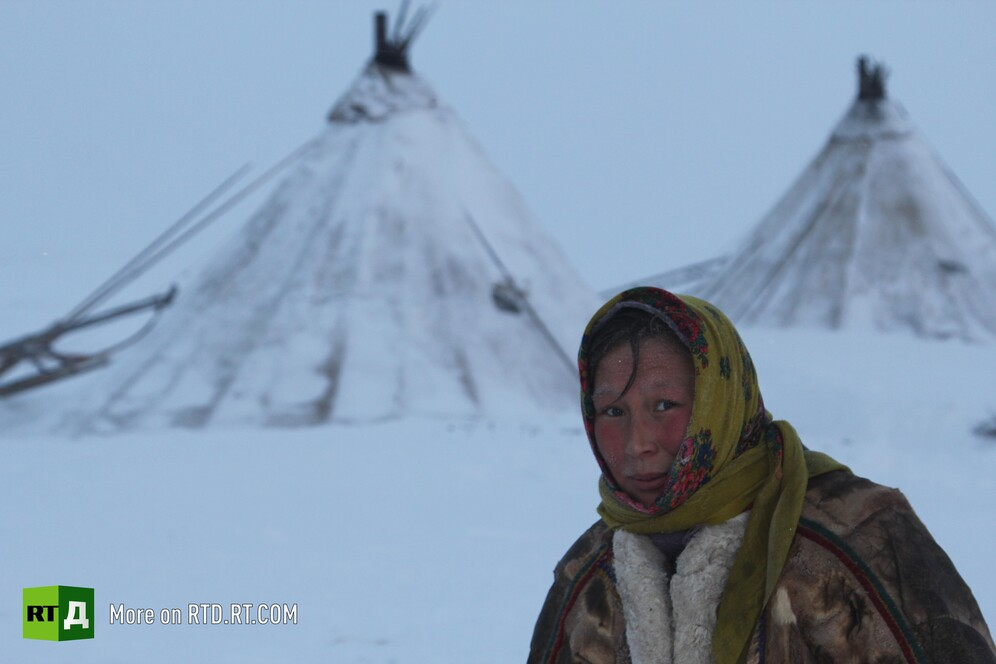 A Nenets woman in front of the chum