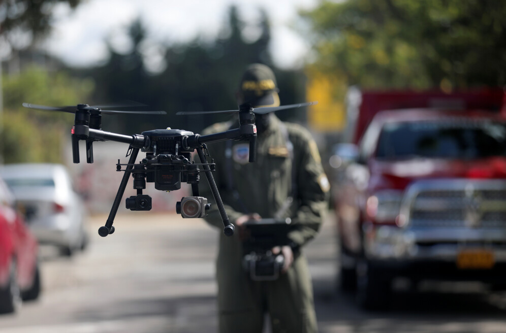police officer in colombia measures temperature with drones