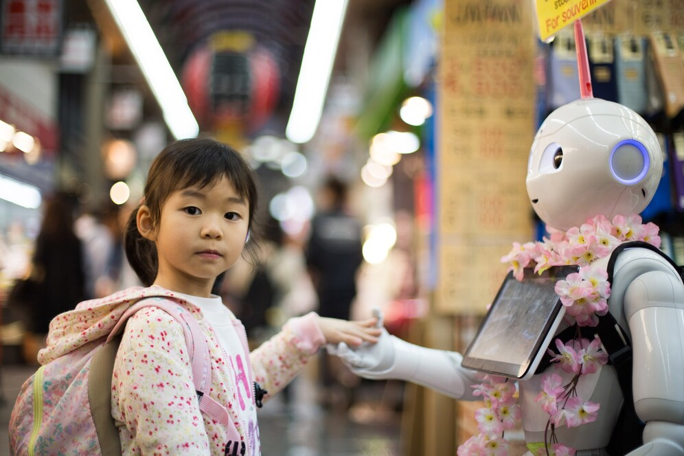 japanese girl making firends with robot