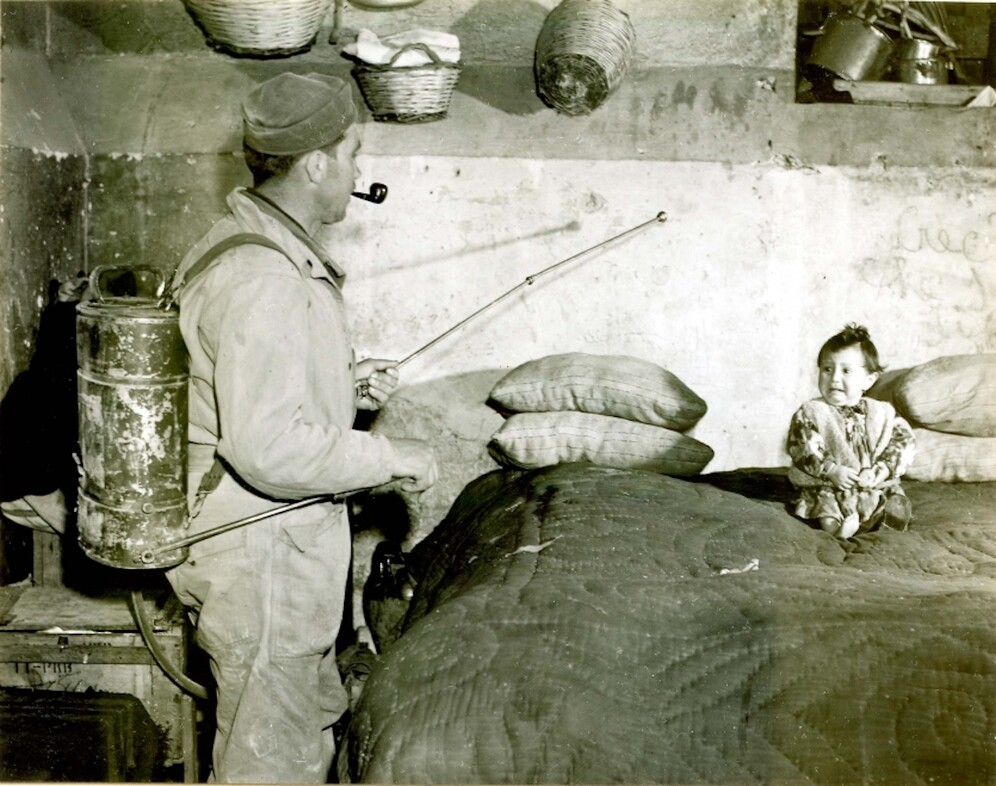 The soldier is spraying DDT mixed with kerosine, Italy, 1945