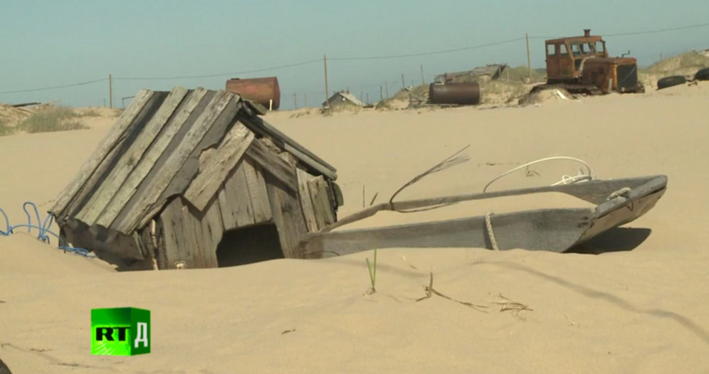 Deep-sea trawling has wiped out all sea bed vegetation causing a build-up of thousands of tons of sand, which is blown on to the land by powerful arctic winds, obliterating houses and buildings. A still from Mysterious Sands of Russia / RTD