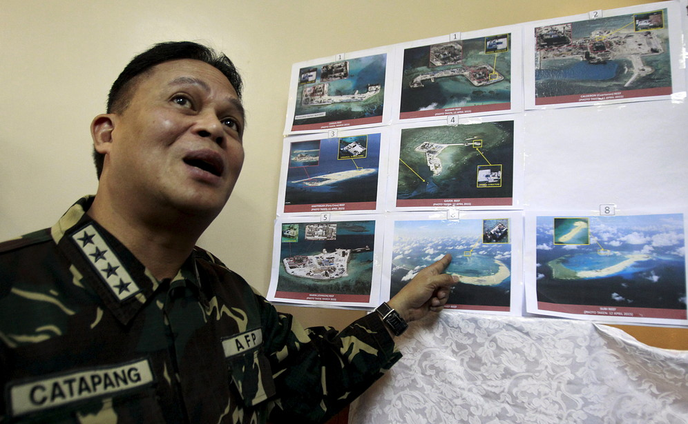 Chief of Staff of the Philippines Armed Gregorio Pio Catapang showing photographs of Chinese constructions on Spratly Islands