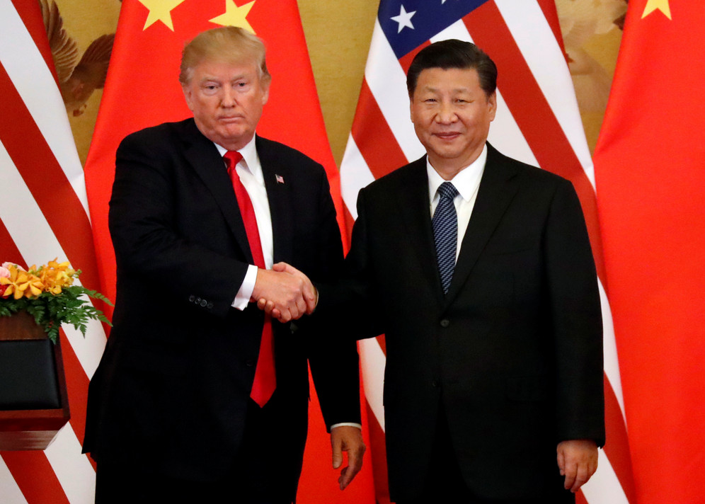 Trump and Jinping shake hands at Great Hall of the Poeple in Beijing
