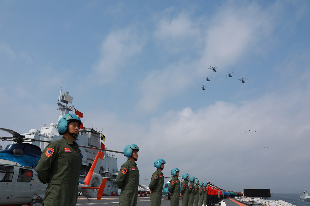 China Navy parading on aircraft carrier in South China Sea