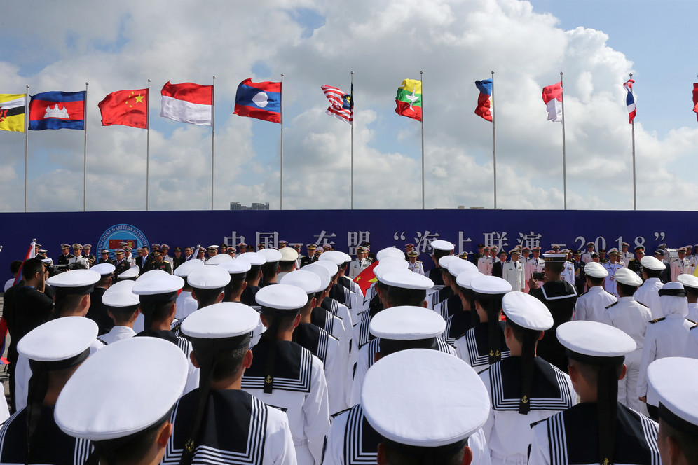 Chinese soldiers and sailors with other ASEA military standing during opening ceremony of China-ASEAN Maritime exercise