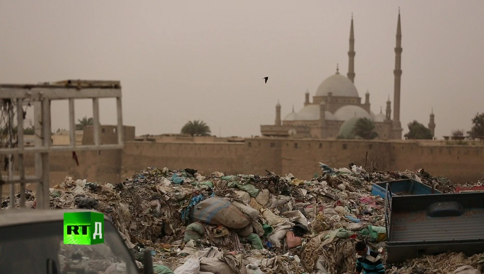 Landfill in the legendary Zabbaleen's Garbage City, with a Cairo mosque in the background, Egypt