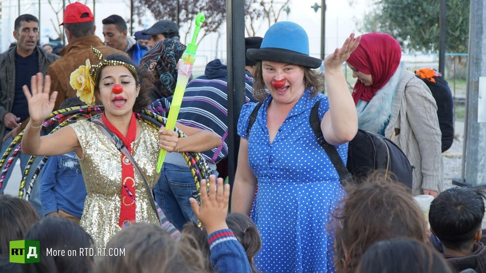 Two women clowns perform for a group of migrant children rescued from the sea in Lesbos, Greece. Still taken from RTD documentary No Laughing Matter.