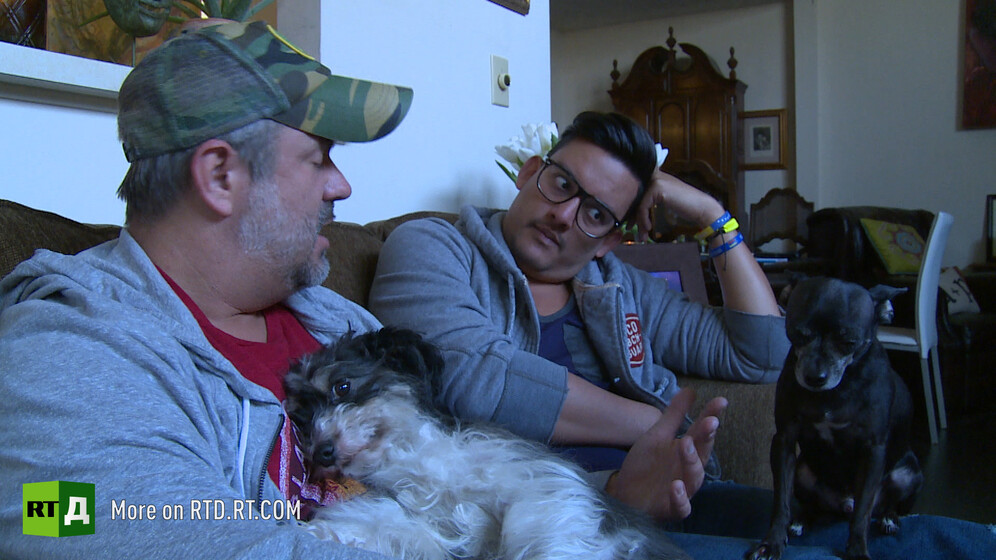 A gay couple with dogs. Still taken from RTD documentary Being gay in the USA.